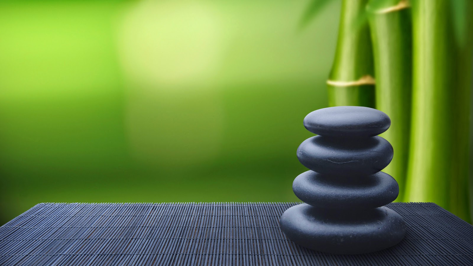Zen-Bamboo-background-image-with-blacl-pebble-stone-image